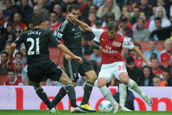 LONDON, ENGLAND - AUGUST 20:  Leiva Lucas of Liverpool attempts to close down Andrey Arshavin of Arsenal during the Barclays Premier League match between Arsenal and Liverpool at the Emirates Stadium on August 20, 2011 in London, England.  (Photo by Micha