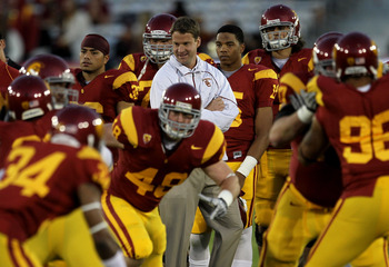 LOS ANGELES - NOVEMBER 27:  Head coach Lane Kiffin of the USC Trojans watches warmups for the game with the Notre Dame Fighting Irish at the Los Angeles Memorial Coliseum on November 27, 2010 in Los Angeles, California.   (Photo by Stephen Dunn/Getty Imag