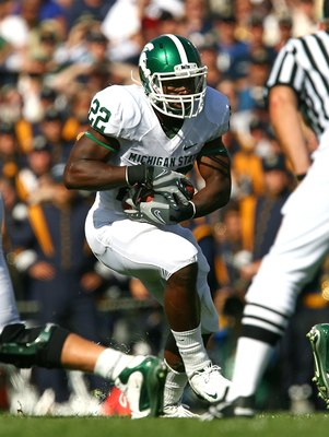 SOUTH BEND, IN - SETPEMBER 19: Larry Caper #22 of the Michigan State Spartans runs against the Notre Dame Fighting Irish on September 19, 2009 at Notre Dame Stadium in South Bend, Indiana. Notre Dame defeated Michigan State 33-30. (Photo by Jonathan Danie