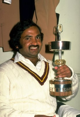 Undated:  Portrait of Mushtaq Mohammad of Pakistan with a trophy in the dressing room after a match. \ Mandatory Credit: Allsport UK /Allsport