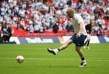 LONDON, ENGLAND - AUGUST 07:  Andrew Flintoff scoring a penalty kick during the half time interval at the FA Community Shield match sponsored by McDonald's between Manchester City and Manchester United at Wembley Stadium on August 7, 2011 in London, Engla