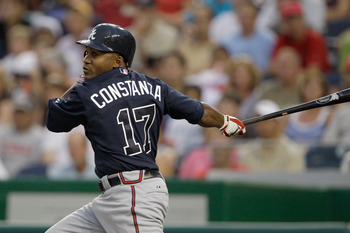 WASHINGTON, DC - AUGUST 02: Jose Constanza #17 of the Atlanta Braves follows his RBI single against the Washington Nationals during the fourth inning at Nationals Park on August 2, 2011 in Washington, DC.  (Photo by Rob Carr/Getty Images)