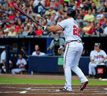 ATLANTA - AUGUST 20: Dan Uggla #26 of the Atlanta Braves hits a first inning home run against the Arizona Diamondbacks at Turner Field on August 20, 2011 in Atlanta, Georgia. (Photo by Scott Cunningham/Getty Images)