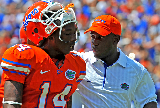GAINESVILLE, FL - APRIL 9:  Defensive backs coach Travaris Robinson of the Florida Gators talks with cornerback Jaylen Watkins #14 during the Orange and Blue spring football game April 9, 2011 Ben Hill Griffin Stadium at Gainesville, Florida.  (Photo by A