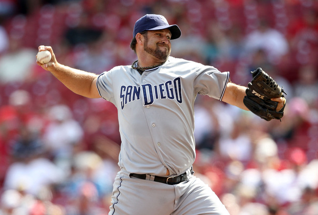 CINCINNATI, OH - AUGUST 14:  Heath Bell #21 of the San Diego Padres throws a pitch during the game against the Cincinnati Reds at Great American Ball Park on August 14, 2011 in Cincinnati, Ohio.  (Photo by Andy Lyons/Getty Images)