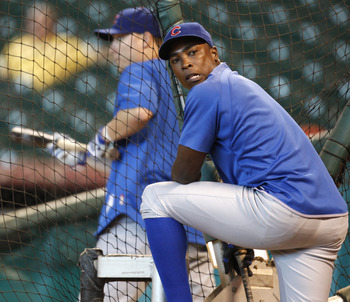 HOUSTON, TX - AUGUST 15: Outfielder Alfonso Soriano #12 of the Chicago Cubs waits to enter the batting cage before their game against the Houston Astros at Minute Maid Park on August 15, 2011 in Houston, Texas.  (Photo by Eric Christian Smith/Getty Images