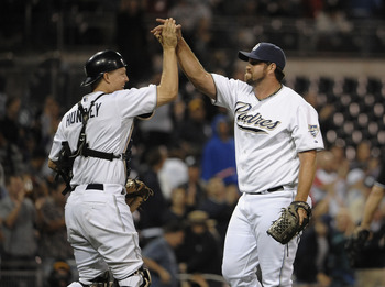 SAN DIEGO, CA - AUGUST 18:  Heath Bell #21 of the San Diego Padres, right, is congratulated by Nick Hundley #4 after getting the final out during the ninth inning of a baseball game against the Florida Marlins at Petco Park on August 18, 2011 in San Diego