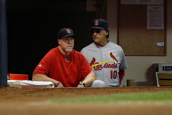 MILWAUKEE, WI - JUNE 10: Tony LaRussa #10 of the St. Louis Cardinals, who is managing in his 5000th game, looks on with Mark McGwire #25 against the Milwaukee Brewers at Miller Park on June 10, 2011 in Milwaukee, Wisconsin. (Photo by Scott Boehm/Getty Ima