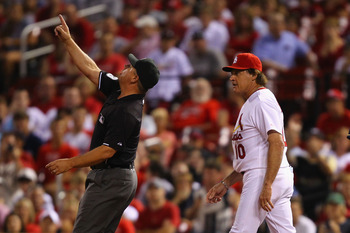 ST. LOUIS, MO - AUGUST 10: Umpire Greg Gibson #53 ejects manager Tony La Russa #10 of the St. Louis Cardinals from the game against the Milwaukee Brewers at Busch Stadium on August 10, 2011 in St. Louis, Missouri.  The Brewers beat the Cardinals 5-1.  (Ph