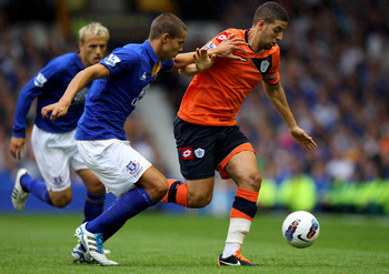 LIVERPOOL, ENGLAND - AUGUST 20:  Jack Rodwell of Everton competes with Adel Taarabat of Queens Park Rangers during the Barclays Premier League match between Everton and Queens Park Rangers at Goodison Park on August 20, 2011 in Liverpool, England.  (Photo