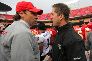 KANSAS CITY, MO - JANUARY 09:  Head coach Todd Haley of the Kansas City Chiefs and head coach John Harbaugh of the Baltimore Ravens meet each other on the field after the Ravens defeated the Chiefs 30-7 in the 2011 AFC wild card playoff game at Arrowhead