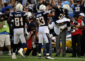 SAN DIEGO, CA - AUGUST 11:  (R-L) Mike Tolbert #35 of the San Diego Chargers reacts with teammates Vincent Jackson #83 and Randy McMichael #81 after scoring on an eight-yard touchdown reception in the first quarter against the Seattle Seahawks during the