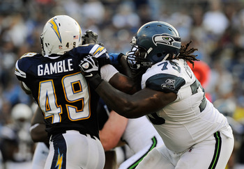 SAN DIEGO, CA - AUGUST 11:  James Carpenter #75 of the Seattle Seahawks defends against Darryl Gamble #49 of the San Diego Chargers during the NFL preseason game at Qualcomm Stadium on August 11, 2011 in San Diego, California.  (Photo by Kevork Djansezian