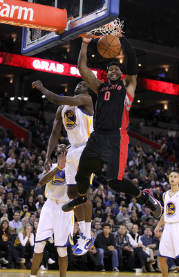 OAKLAND, CA - MARCH 25:  James Johnson #0 of the Toronto Raptors dunks in front of Ekpe Udoh #20 of the Golden State Warriors at Oracle Arena on March 25, 2011 in Oakland, California. NOTE TO USER: User expressly acknowledges and agrees that, by downloadi