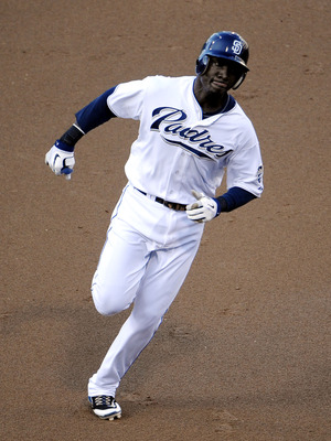 SAN DIEGO, CA - JULY 16: Orlando Hudson #1 of the San Diego Padres rounds the bases after hitting a three-run home run during the third inning of a baseball game at Petco Park on July 16, 2011 in San Diego, California. (Photo by Denis Poroy/Getty Images)