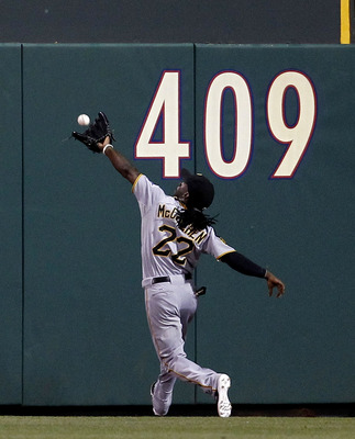 PHILADELPHIA, PA- JULY 30:  Andrew McCutchen #22 of the Pittsburgh Pirates can't get to a long fly ball hit by Ryan Howard #6 of the Philadelphia Phillies at Citizens Bank Park on July 30, 2011 in Philadelphia, Pennsylvania.  (Photo by Jeff Zelevansky/Get
