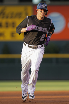 DENVER, CO - AUGUST 16:  Troy Tulowitzki #2 of the Colorado Rockies rounds the bases on his solo homerun off of Anibal Sanchez #19 of the Florida Marlins in the second inning at Coors Field on August 16, 2011 in Denver, Colorado.  (Photo by Doug Pensinger