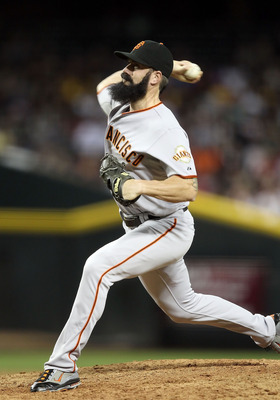 PHOENIX, AZ - JUNE 14:  Relief pitcher Brian Wilson #38 of the San Francisco Giants pitches against the Arizona Diamondbacks during the Major League Baseball game at Chase Field on June 14, 2011 in Phoenix, Arizona. The Giants defeated the Diamondbacks 6-