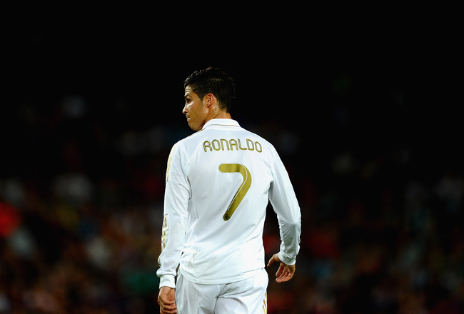 BARCELONA, SPAIN - AUGUST 17: Cristiano Ronaldo of Real Madrid shows his frustration after the second goal during the Super Cup second leg match between Barcelona and Real Madrid at Nou Camp on August 17, 2011 in Barcelona, Spain.  (Photo by Laurence Grif