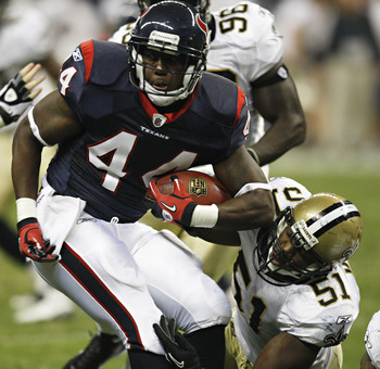 HOUSTON - AUGUST 20:  Running back Ben Tate #44 of the Houston Texans breaks loose from a tackle by linebacker Jonathan Vilma #51 of the New Orleans Saints at Reliant Stadium on August 20, 2011 in Houston, Texas.  (Photo by Bob Levey/Getty Images)
