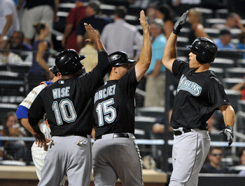 NEW YORK, NY - AUGUST 01: Mike Stanton #27 of the Florida Marlins (far right) is congratulated after connecting for a grand slam in the top of the tenth inning against the New York Mets at Citi Field on August 1, 2011 in the Flushing neighborhood of the Q
