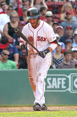 BOSTON, MA  - JULY 4: Dustin Pedroia #15 of the Boston Red Sox reacts after striking out in the ninth inningagainst the Toronto Blue Jays at Fenway Park on July 4, 2011 in Boston, Massachusetts.  (Photo by Jim Rogash/Getty Images)