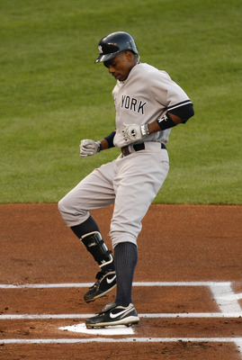 KANSAS CITY, MO - AUGUST 17:  Curtis Granderson #14 of the New York Yankees crosses home after hitting a home run in the first inning during a game against the Kansas City Royals at Kauffman Stadium on August 17, 2011 in Kansas City, Missouri. (Photo by E