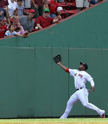 BOSTON - AUGUST 17:  Carl Crawford #13 of the Boston Red Sox comes up short on a foul ball against the Tampa Bay Rays at Fenway Park on August 17, 2011 in Boston, Massachusetts.  (Photo by Jim Rogash/Getty Images)