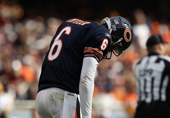 CHICAGO - OCTOBER 24: Jay Cutler #6 of the Chicago Bears reacts after throwing an interception against the Washington Redskins at Soldier Field on October 24, 2010 in Chicago, Illinois. The Redskins defeated the Bears 17-14. (Photo by Jonathan Daniel/Gett