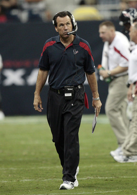 HOUSTON - AUGUST 15:  Head Coach Gary Kubiak of the Houston Texans checks the scoreboard during a pre-season football game against the New York Jets at Reliant Stadium on August 15, 2011 in Houston, Texas. Houston won 20-16.  (Photo by Bob Levey/Getty Ima