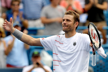 MASON, OH - AUGUST 19:  Mardy Fish ackowledges the crowd after defeating Rafael Nadal of Spain during the Western & Southern Open at the Lindner Family Tennis Center on August 19, 2011 in Mason, Ohio.  (Photo by Matthew Stockman/Getty Images)