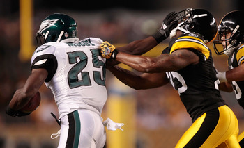 PITTSBURGH - AUGUST 18:  LaSean McCoy #25 of the Philadelphia Eagles stiff arms Ryan Clark #25 of the Pittsburgh Steelers during the preseason game on August 18, 2011 at Heinz Field in Pittsburgh, Pennsylvania.  (Photo by Jared Wickerham/Getty Images)