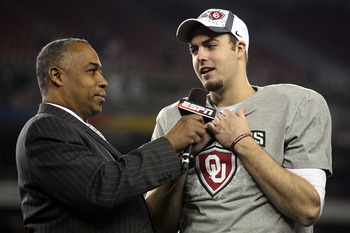 GLENDALE, AZ - JANUARY 01:  Quarterback Landry Jones #12 of the Oklahoma Sooners and offensive MVP is interviewed by ESPN's John Saunders after the Sooners 48-20 victory against the Connecticut Huskies during the Tostitos Fiesta Bowl at the Universtity of