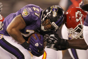 BALTIMORE, MD - AUGUST 19: Running back Ray Rice #27 of the Baltimore Ravens (L) is tackled by linebacker Jovan Belcher #59 of the Kansas City Chiefs during the first half of a preseason game at M&T Bank Stadium on August 19, 2011 in Baltimore, Maryland.
