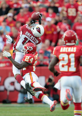 KANSAS CITY, MO - NOVEMBER 21:  Receiver Steve Breaston #15 of the Arizona Cardinals makes a catch as Brandon Flowers #24 of the Kansas City Chiefs defends during the game on November 21, 2010 at Arrowhead Stadium in Kansas City, Missouri.  (Photo by Jami