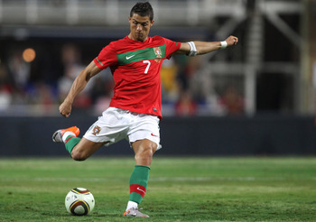JOHANNESBURG, SOUTH AFRICA - JUNE 08:  Cristiano Ronaldo crosses the ball against Mozambique during their game at Wanderers Stadium on June 8, 2010 in Johannesburg, South Africa.  (Photo by Streeter Lecka/Getty Images)