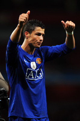 LONDON, ENGLAND - MAY 05:  Cristiano Ronaldo of Manchester United acknowledges the fans after victory in the UEFA Champions League Semi Final Second Leg match between Arsenal and Manchester United at Emirates Stadium on May 5, 2009 in London, England.  (P