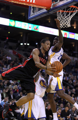 OAKLAND, CA - MARCH 25: DeMar DeRozan #10 of the Toronto Raptors drives around Ekpe Udoh #20 of the Golden State Warriors at Oracle Arena on March 25, 2011 in Oakland, California. NOTE TO USER: User expressly acknowledges and agrees that, by downloading a