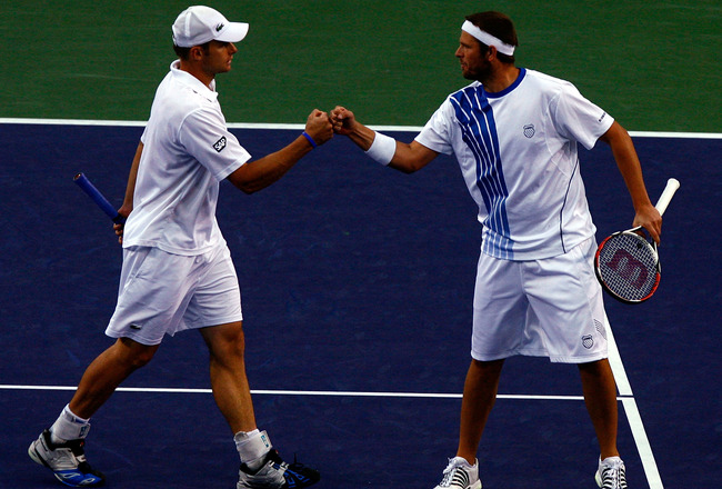 INDIAN WELLS, CA - MARCH 21:  (L-R) Andy Roddick and Mardy Fish celebrate a point during their victory over Max Mirnyi of Belarus and Andy Ram of Israel in the men's doubles final of the BNP Paribas Open on March 21, 2009 at the Indian Wells Tennis Garden