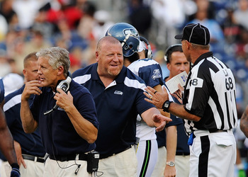 SAN DIEGO, CA - AUGUST 11: Assistant head coach Tom Cable (C) of the Seattle Seahawks points at  line judge Tom Stephan #68 during the NFL preseason game at Qualcomm Stadium against the San Diego Chargers on August 11, 2011 in San Diego, California.  (Pho