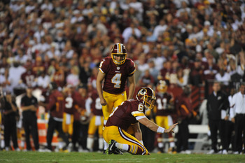 LANDOVER - SEPTEMBER 12:  Graham Gano #4 of the Washington Redskins prepares to kick during the NFL season opener against the Dallas Cowboys at FedExField on September 12, 2010 in Landover, Maryland. The Redskins defeated the Cowboys 13-7. (Photo by Larry