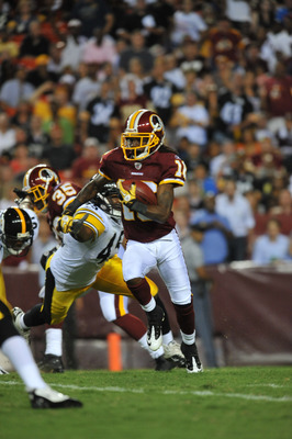 LANDOVER, MD - AUGUST 12:  Brandon Banks #16 of the Washington Redskins returns a punt against the Pittsburgh Steelers  at FedExField on August 12, 2011 in Landover, Maryland. The Redskins defeated the Steelers 16-7. (Photo by Larry French/Getty Images)