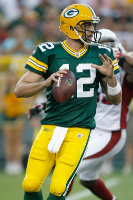 GREEN BAY, WI - AUGUST 19: Aaron Rogers #12 of the Green Bay Packers passes against the Arizona Cardinals in a preseason game at Lambeau Field on August 19, 2011 in Green Bay, Wisconsin. (Photo by Scott Boehm/Getty Images)