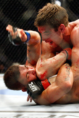 MONTREAL- MAY 8: Sam Stout (top) hits Jeremy Stephens with his elbow in their lightweight 'swing' bout at UFC 113 at Bell Centre on May 8, 2010 in Montreal, Quebec, Canada. Jeremy Stephens won the bout by KO. (Photo by Richard Wolowicz/Getty Images)