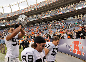 DENVER - OCTOBER 24:  Defensive end Richard Seymour #92 of the Oakland Raiders celebrates while the Raiders 59-14 over the Denver Broncos while walking off the field with teammates Nick Miller #89 and Ricky Brown #57 at INVESCO Field at Mile High on Octob
