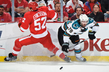 DETROIT - MAY 4: Jonathan Ericsson #52 of the Detroit Red Wings and Benn Ferriero #78 of the San Jose Sharks collide in Game Three of the Western Conference Semifinals during the 2011 NHL Stanley Cup Playoffs on May 4, 2011 at Joe Louis Arena in Detroit,