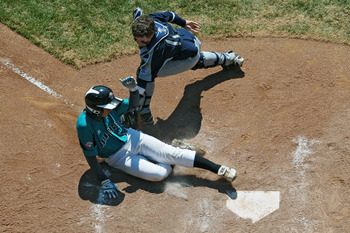 SOUTH WILLAMSPORT, PA - AUGUST 29:  Chao-Yu Chu #15 of Chinese Taipei gets tagged out at home plate by Beau Orlando #10 of Pearland, Texas on August 29, 2010 in South Willamsport, Pennsylvania. Chinese Taipei won the Little League World Series Consolation