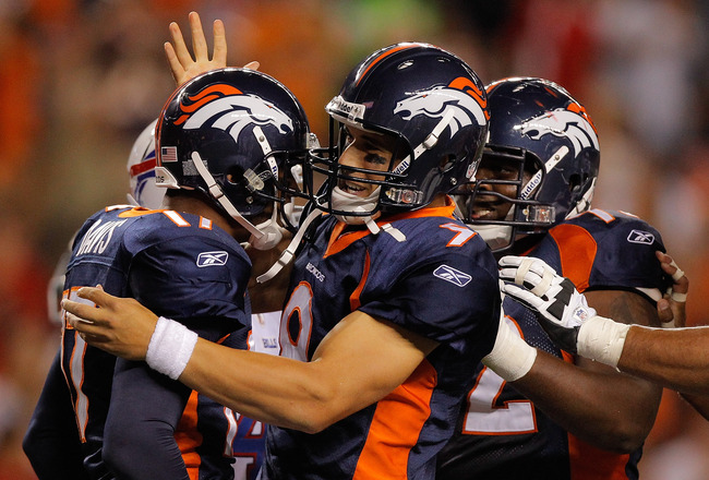 DENVER, CO - AUGUST 20:  Quarterback Brady Quinn #9 of the Denver Broncos and offensive tackle Herb Taylor #72 celebrate with wide receiver Britt Davis #17 after he scored a touchdown during the third quarter against the Buffalo Bills at Sports Authority