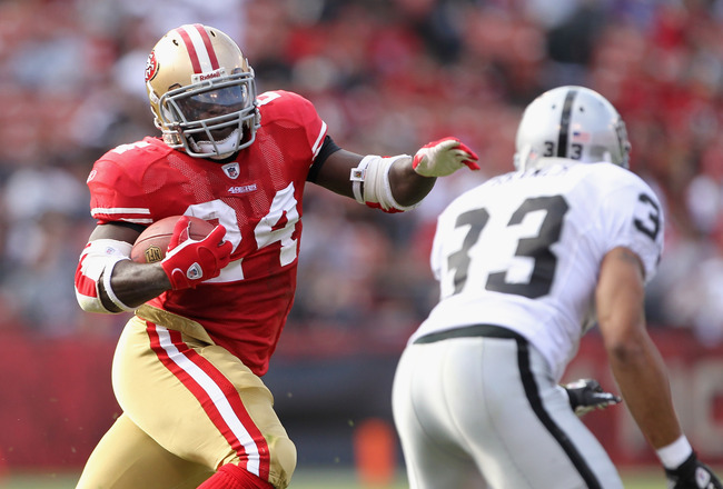 SAN FRANCISCO, CA - AUGUST 20:  Anthony Dixon #24 of the San Francisco 49ers runs with the ball against the Oakland Raiders at Candlestick Park on August 20, 2011 in San Francisco, California.  (Photo by Ezra Shaw/Getty Images)
