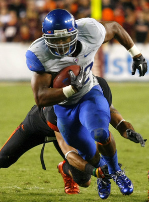 LANDOVER, MD - SEPTEMBER 06:  Running back #22 Doug Martin of the Boise State Broncos runs past linebacker #43 Jeron Gouveia-Winslow of the Virginia Tech Hokies at FedExField on September 6, 2010 in Landover, Maryland.  (Photo by Geoff Burke/Getty Images)